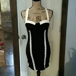 Black and white form fitting dress.